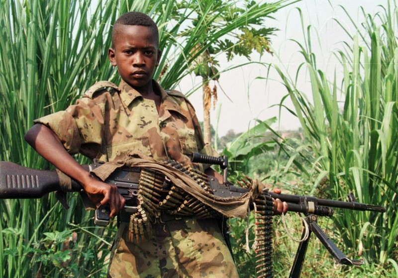 uganda child soldiers Starting in 1996, the ugandan government, unable to stop the lra, required the people of northern uganda to leave their villages and enter government-run camps for internally displaced persons (idps.